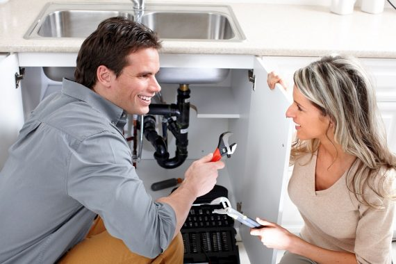Plumber Talking To A Customer
