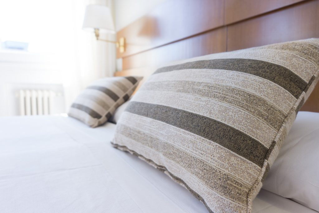 White Bed Patterned Pillows